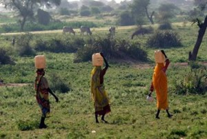 ladies carrying water