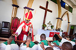 Led by Bishop Emmanuel Makala (standing), 21 new pastoral candidates are ordained in a service with more than 1,000 worshippers on Sunday, March 15, 2015, at the Evangelical Lutheran Church in Tanzania Ð South-East of Lake Victoria Diocese's (ELCT-SELVD) Ebenezer Cathedral in Shinyanga, Tanzania. LCMS Communications/Erik M. Lunsford