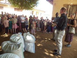 Block and Rheim deliver food to albino compound